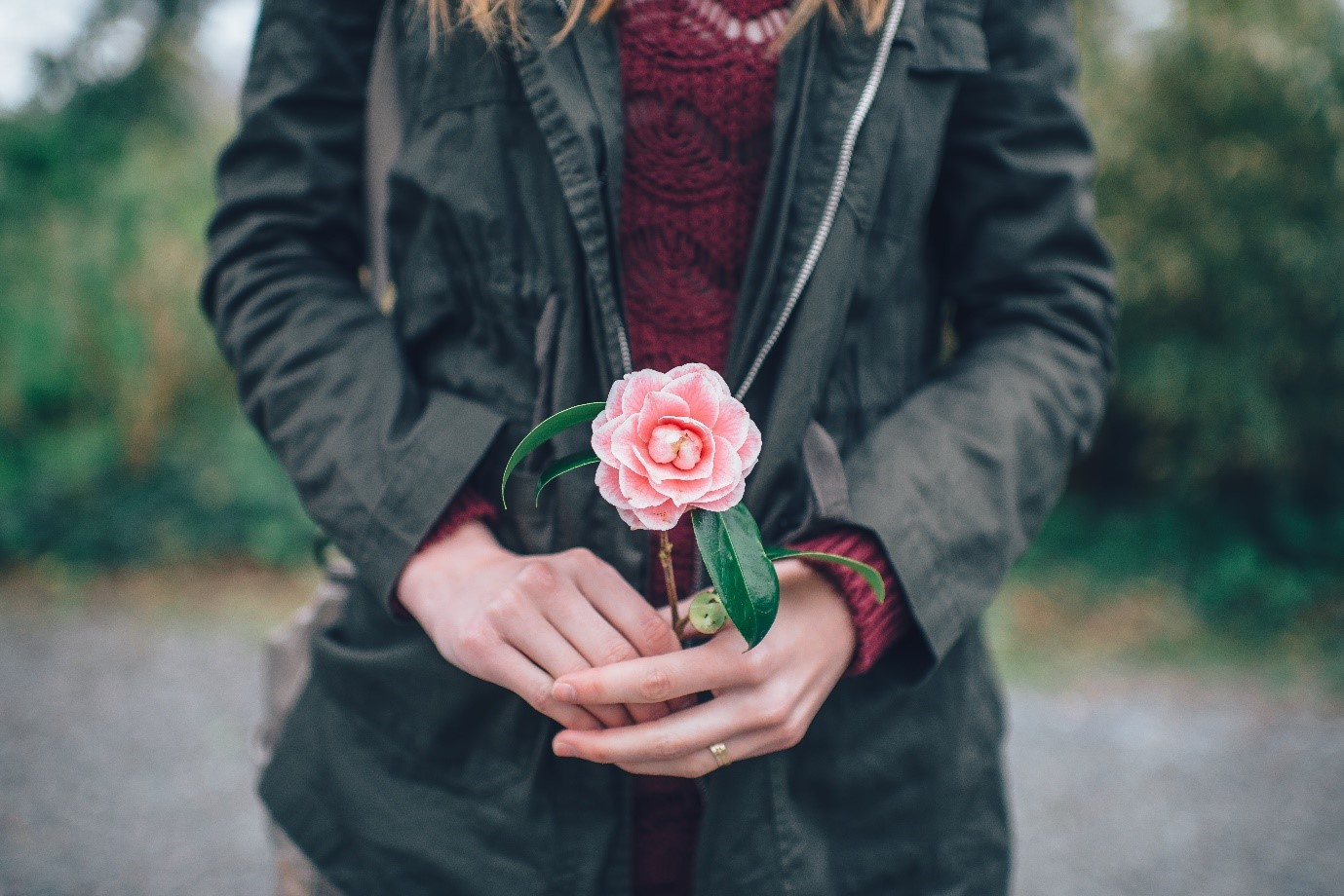How to take good photos – woman holding flower as prop